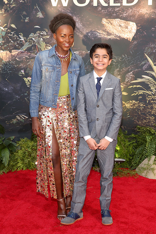 "HOLLYWOOD, CALIFORNIA - APRIL 04: Actors Lupita Nyong'o and Neel Sethi attend The World Premiere of Disney's ""THE JUNGLE BOOK"" at the El Capitan Theatre on April 4, 2016 in Hollywood, California. (Photo by Jesse Grant/Getty Images for Disney) *** Local Caption *** Neel Sethi; Lupita Nyong'o"